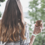women with mug staring out