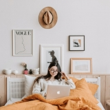 women using laptop in bed