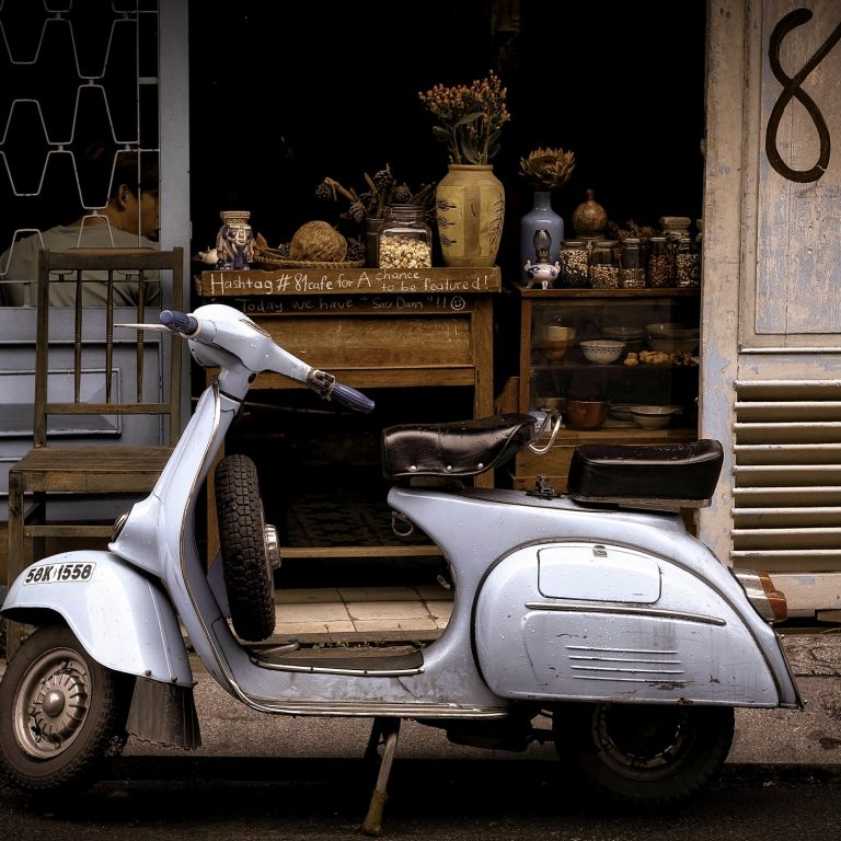 vespa in front of rustic building