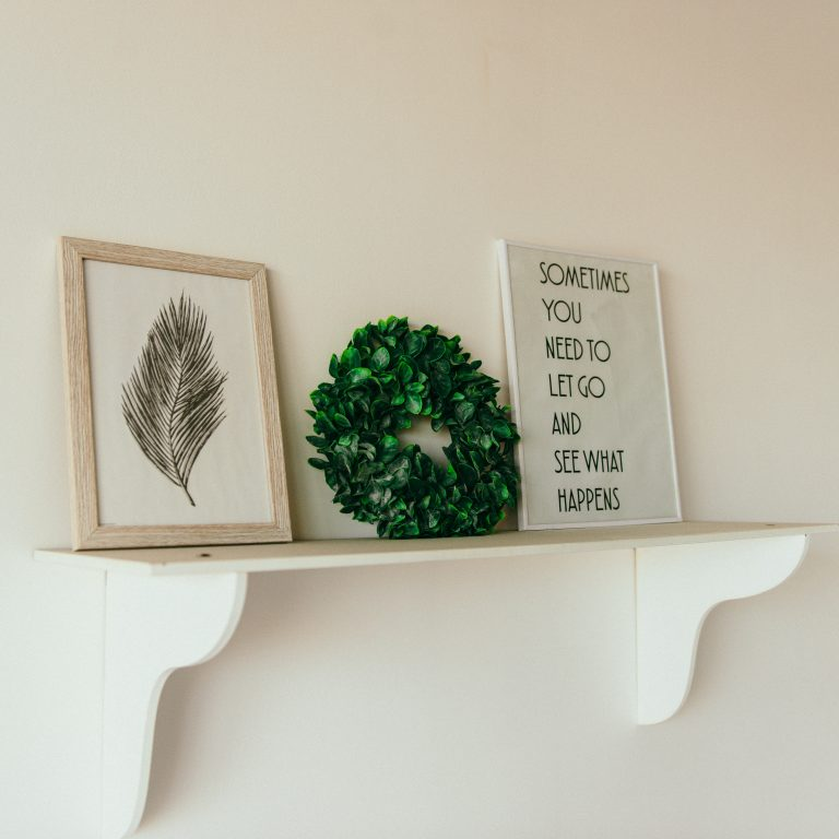 plants on shelf with quote
