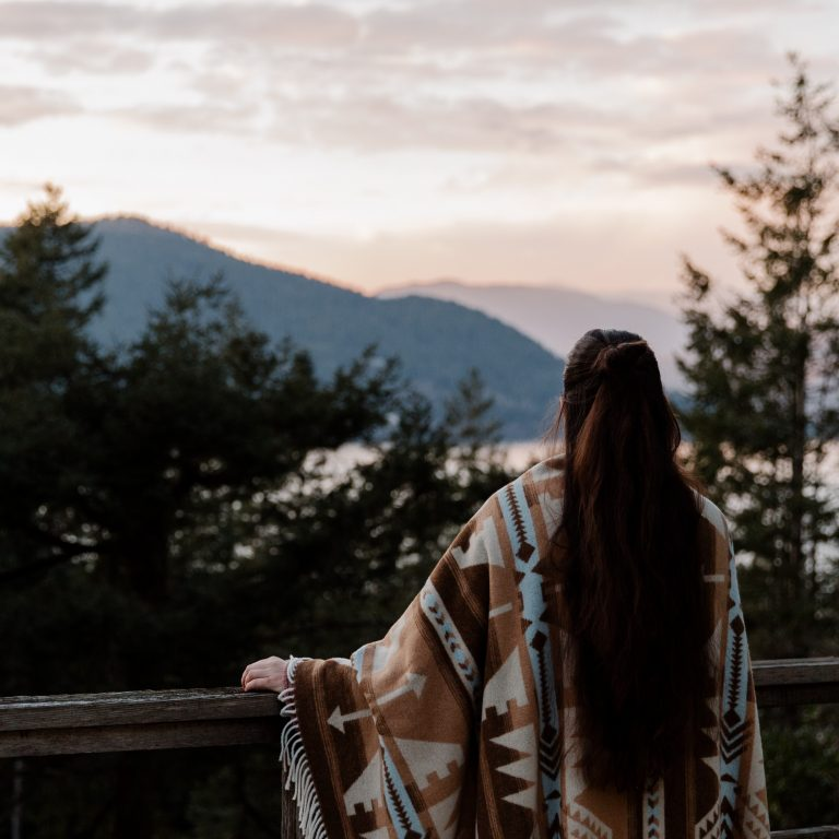long haired woman enjoys scenic view from terrace
