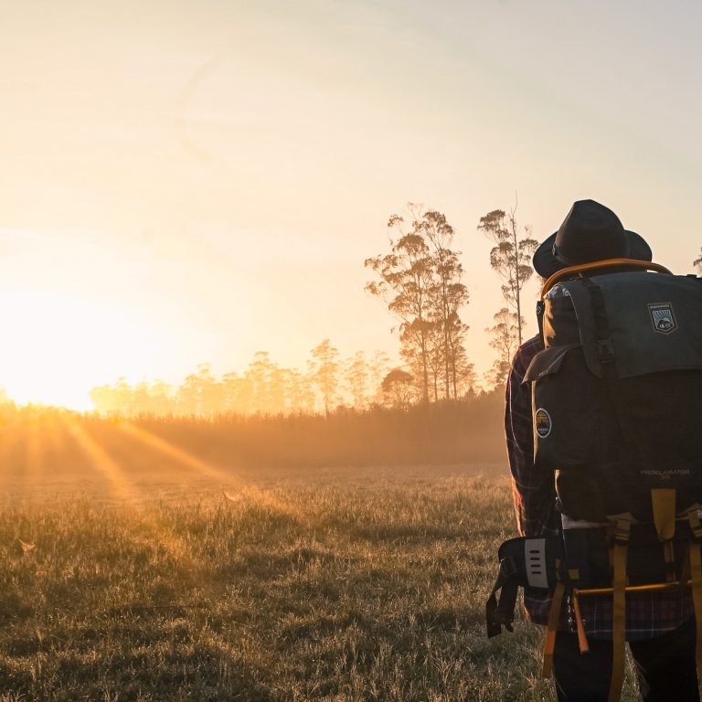 man standing in backpacking backpack
