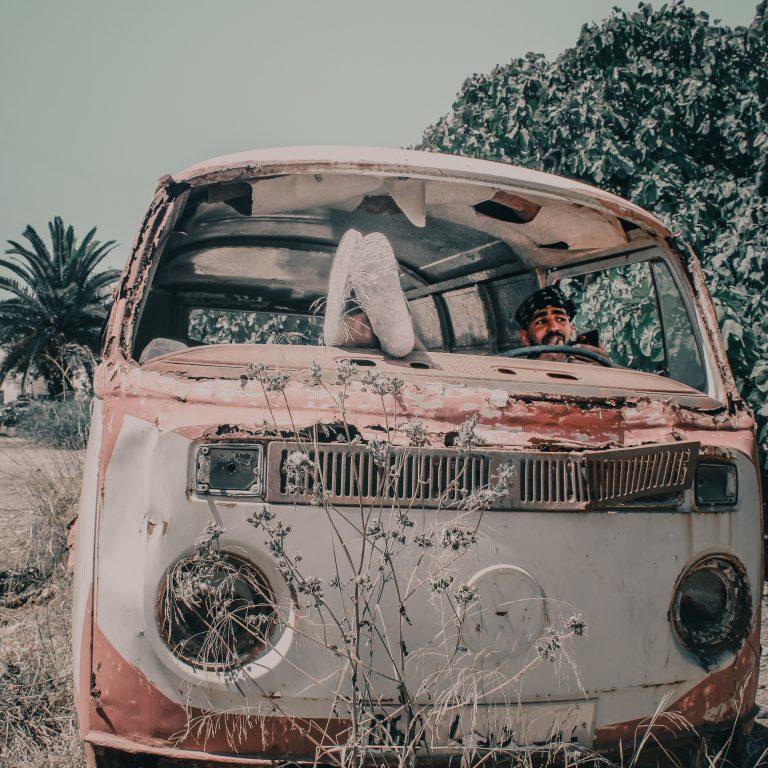 white and pink old volkswagen van